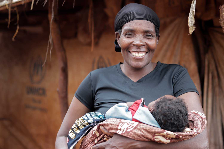 Refugee artisan with child