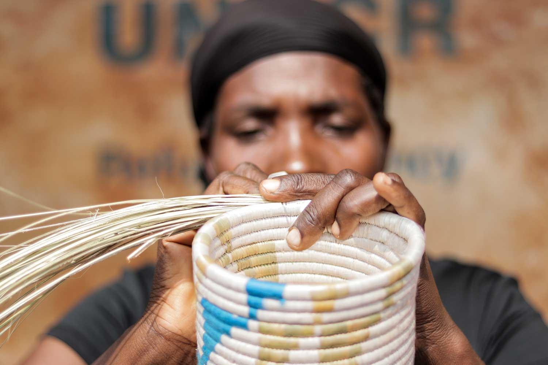 Refugee artisan weaving blue kitwaro