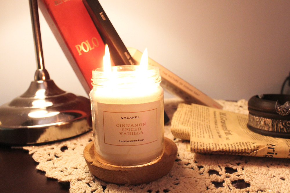cinnamon vanilla candle with books