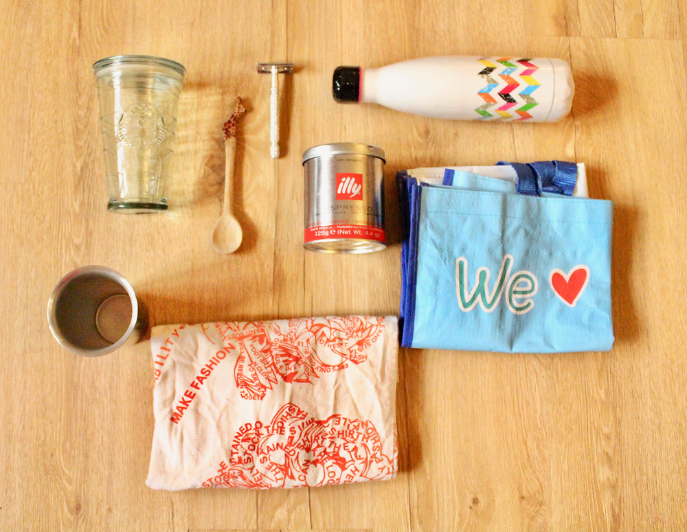 aluminum bottle, canvas bag, metal razor, recycled bag, glass bottle