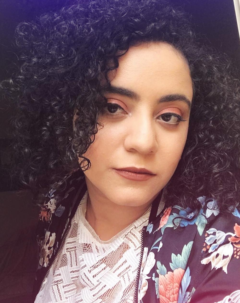 Lobna Hossam makeup artist girl with curly hair