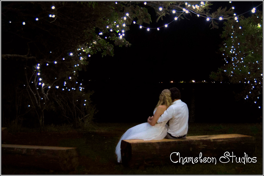 Bridal couple under fairy lights