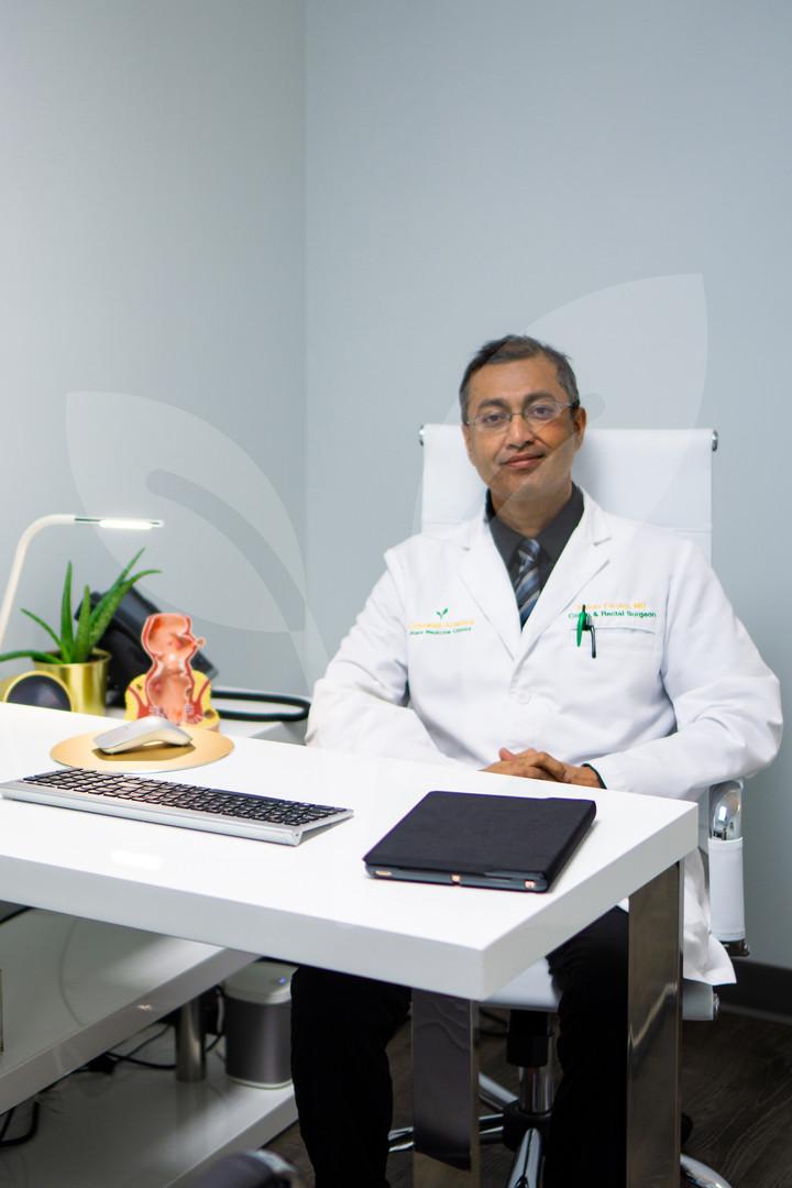 Doctor Farooq at desk