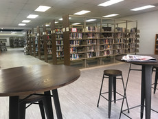 Photo of library bookshelves and pub seating area