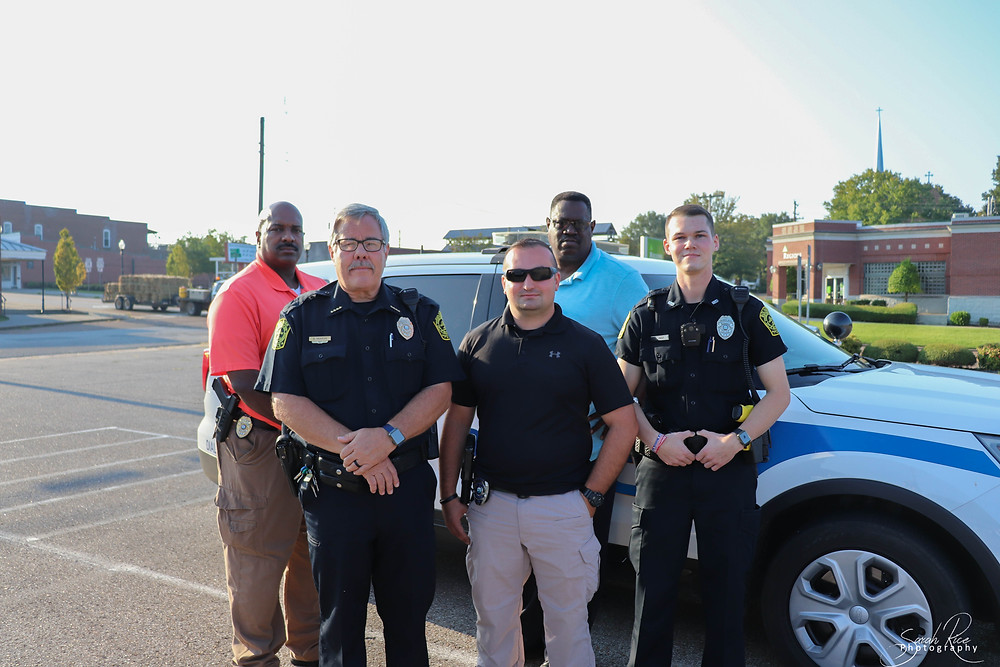 Photo of Chief Jones, Investigator Futrell, Assistant Chief Henson, Officer Hasapis, and Officer Frost