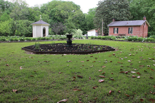 wide angle photo of flower garden at The Bills-McNeal House