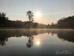Photo of pond at sunrise
