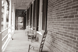 Photo of the back porch at The Pillars