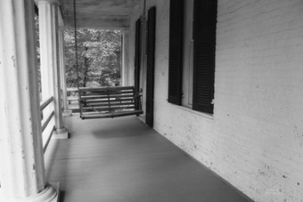 Photo of swing on front porch
