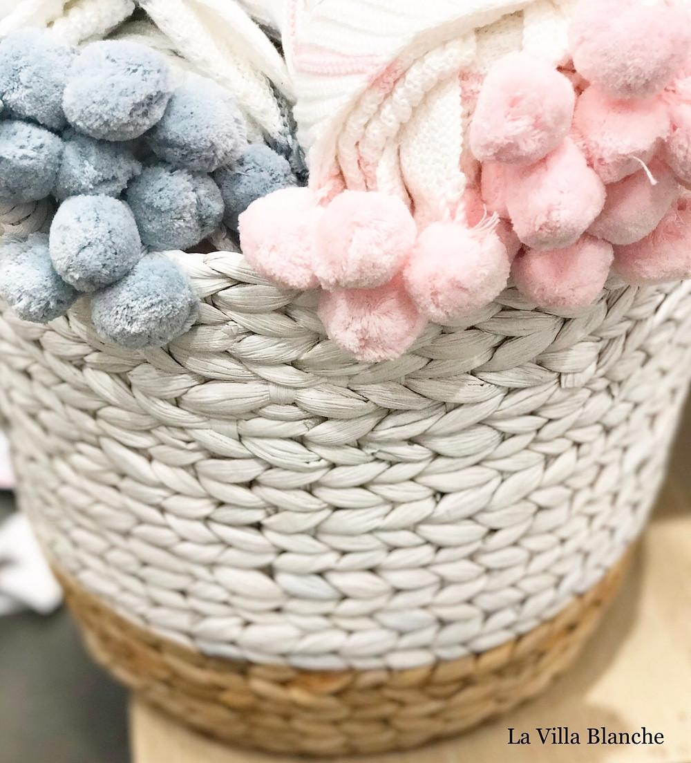 pompoms in a white wicker basket