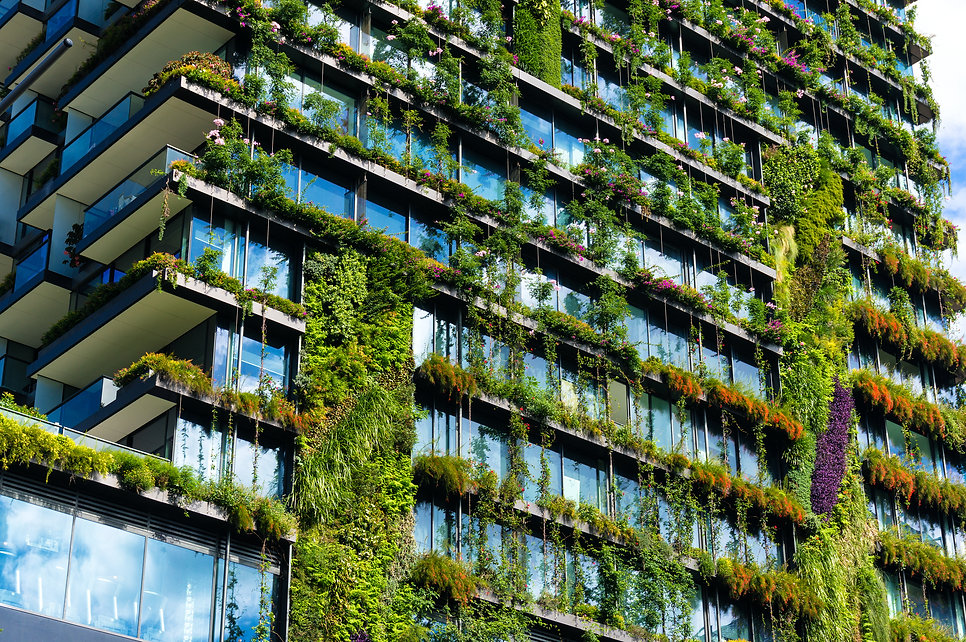 Green skyscraper building with plants gr