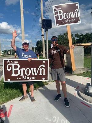 brown sign waving.jpg