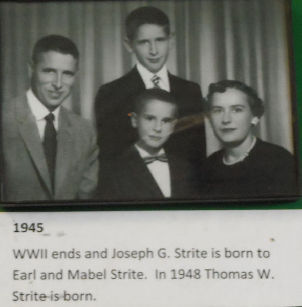 1945 photo of Joseph and Thomas Strite wih arents Earl and Mabel.