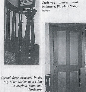 Wooden stairway and second floor door of the Martin Nisley House.