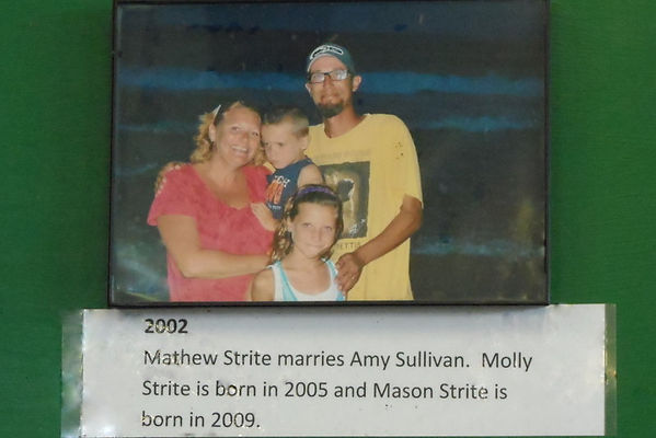 2002 Photo of Mathew and Amy Strite ad their children Molly and Mason.