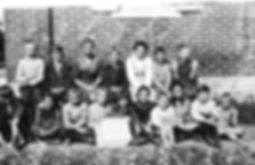 Students and teacher in front of Stoner School