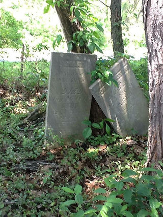 Two gravestones of Mary and Daniel.