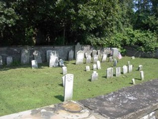 Photo of the inside of the cemetary showing the old headstones.