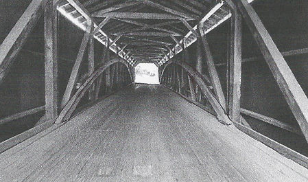 Example of a covered bridge from underneath looking at the structural part of the roof