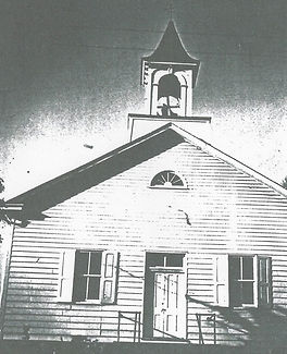 Photo of the front view of the Ebenezer Church when it had wooden clapboards.