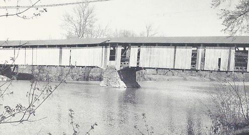 Side view of Cliton Covered Bridge and water