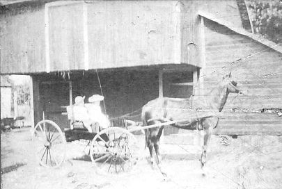 Photo of Barn with carriage in front of