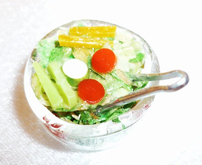 Salad in bowl with Tongs