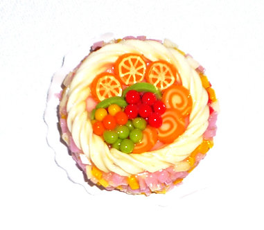 Round Cake with Fruit and Yellow Frosting