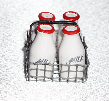 4 Milk Bottles in a Wire Crate