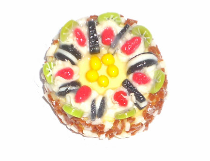 Round Cake topped with sandwich cookies and fruit