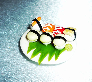 Sushi on round white plate