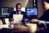 group-of-entrepreneur-analysing-for-inve