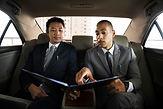 business-men-talk-report-inside-car-PP83