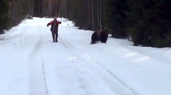 Man scares bear with roar