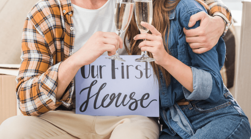 Couple celebrating the purchase of their first home
