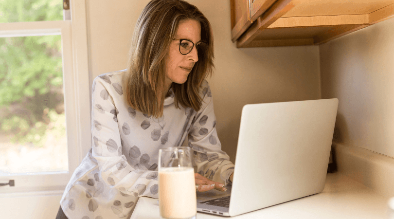 Woman calculating how much she needs to retire comfortably