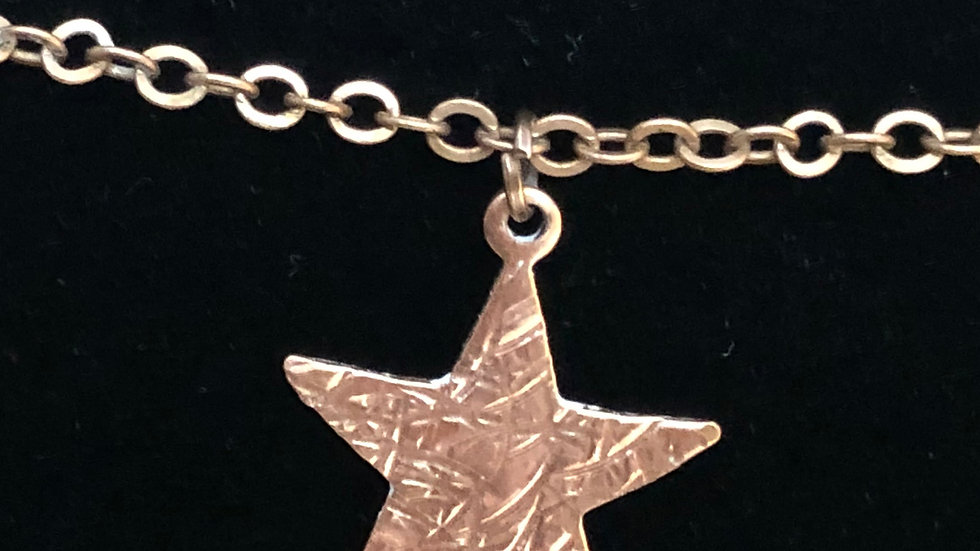 Copper textured star necklace