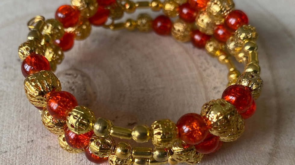 Red and gold filigree memory wire bracelet