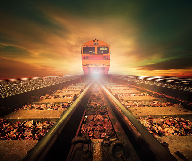 Trains On Junction Of Railways Track In Trains Station Agains Beautiful Light Of Sun Set Sky Use For