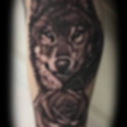 black and grey realitic wol and rose tattoo