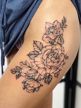 thigh leg tattoo sketchy linework flowers on hip