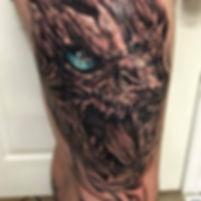 black and grey dragon pop colour tattoo