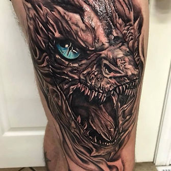 black and grey dragon pop colour tattoo