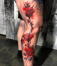 trash polka red poppy leg tattoo