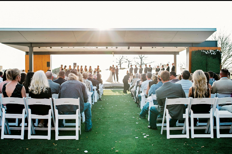 Outdoor wedding ceremony held at Lake Walk Town Cenerin Bryan, Texas.