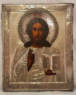 An early russian icon in sterling silver was found behind a wall in Palenville NY along with rare early photos that set a auction record at Scott Daniels GoNBid Auction