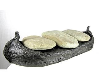 Ship carrying flat stones