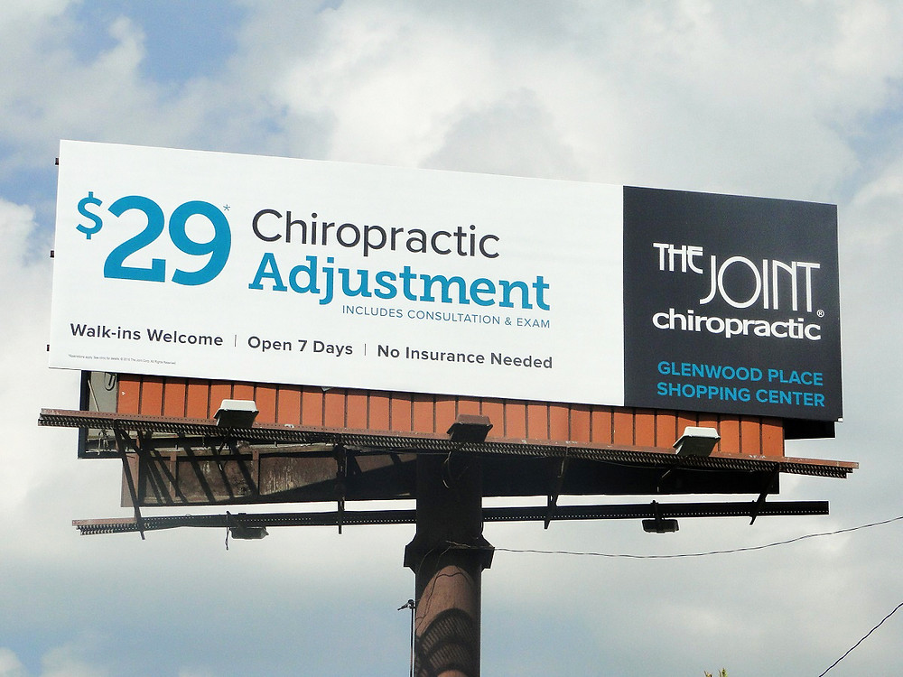 The Joint Chiropractic billboard
