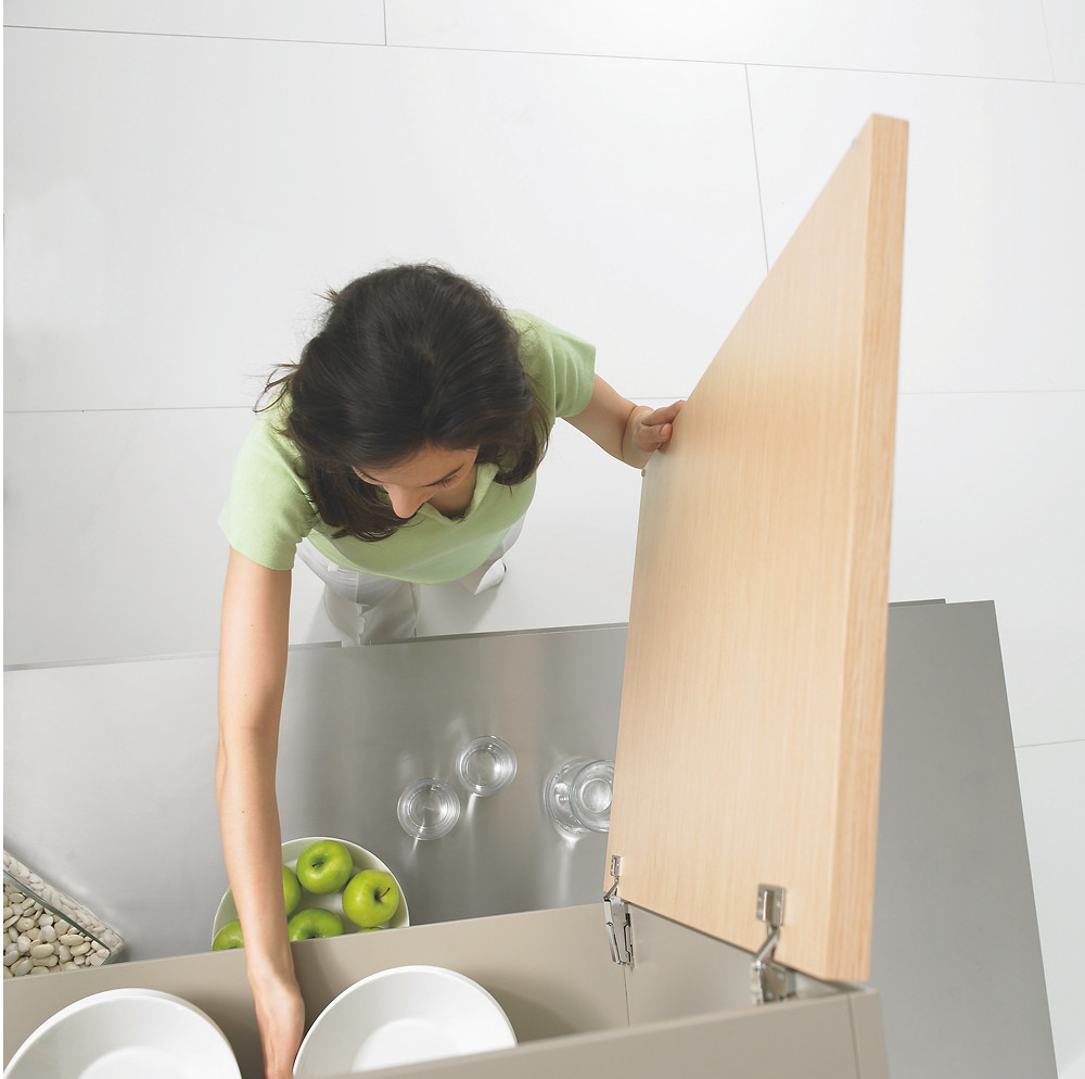 woman putting dishes back in cupboard