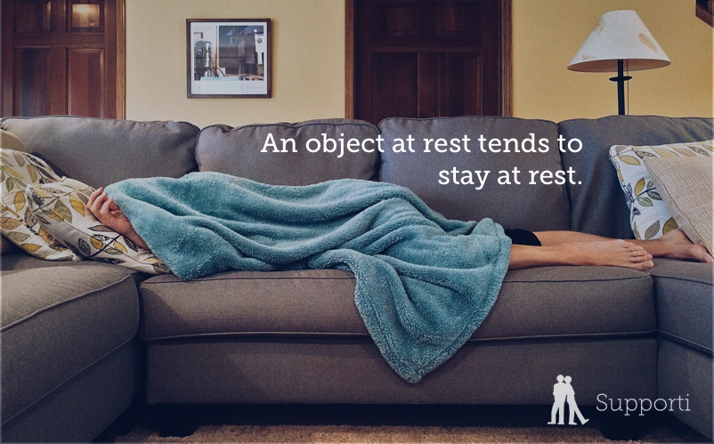 "lazy person on the couch with blanket covering them. Text reads ""an object at rest tends to stay at rest."""